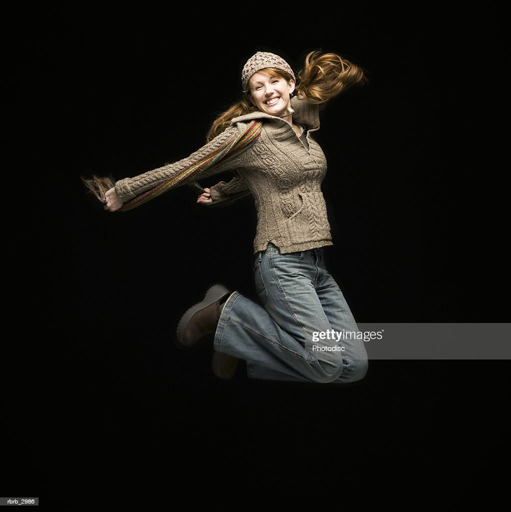 Portrait of a woman jumping : Foto de stock