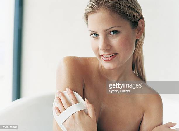 Portrait of a Woman Massaging Her Arm