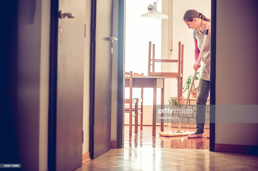 Portrait of a Woman Mopping Floor : Stock Photo