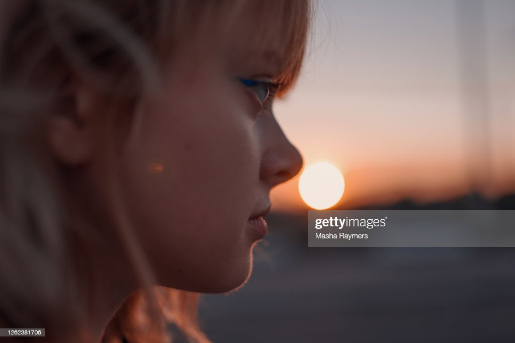 Portrait of a woman near the road at sunset : Stock Photo