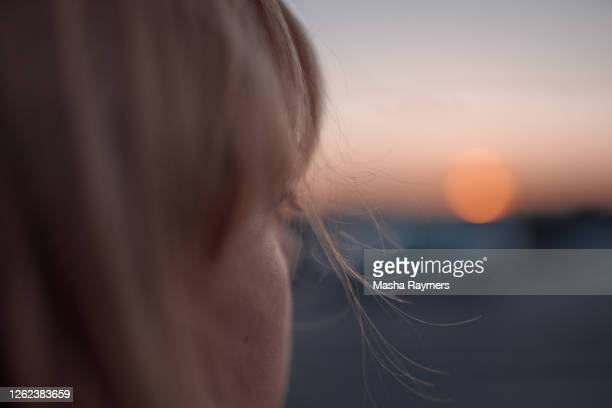 portrait of a woman near the road at sunset - dusk stock pictures, royalty-free photos & images