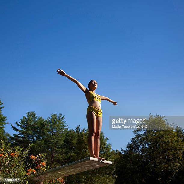 Portrait of a woman on a springboard