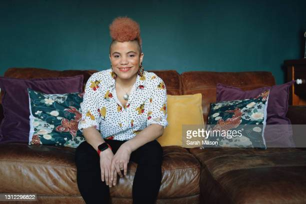 portrait of a woman on sofa - one mid adult woman only stock pictures, royalty-free photos & images