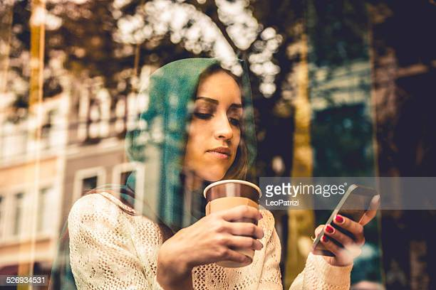 Portrait of a woman on the window of a cafe