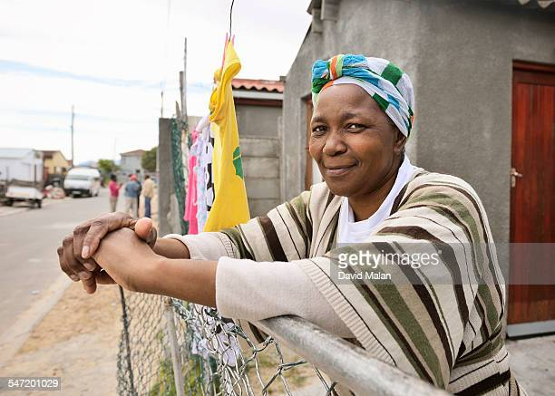 Portrait of a Woman outside her home. Cape Town, South Africa