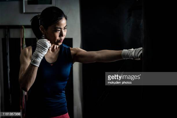 portrait of a woman - punching stock pictures, royalty-free photos & images