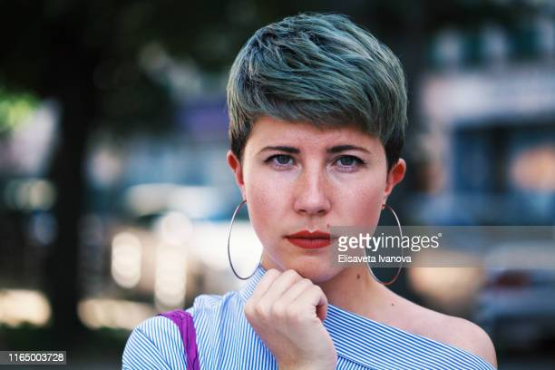 portrait of a woman - non binary gender stock pictures, royalty-free photos & images