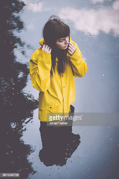 portrait of a woman - yellow coat stock pictures, royalty-free photos & images