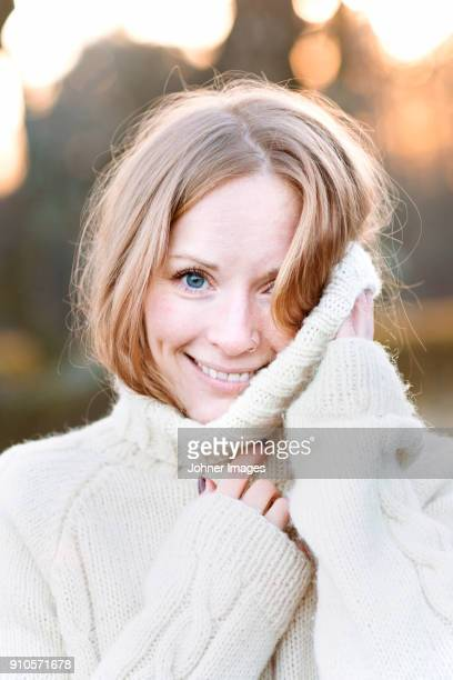 portrait of a woman - polo neck stock pictures, royalty-free photos & images