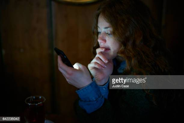 Portrait of a woman reading message on her phone
