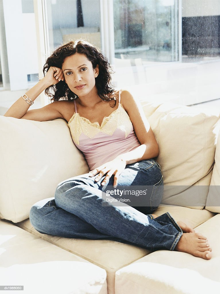 Portrait of a Woman Relaxing on a Sofa : Stock Photo