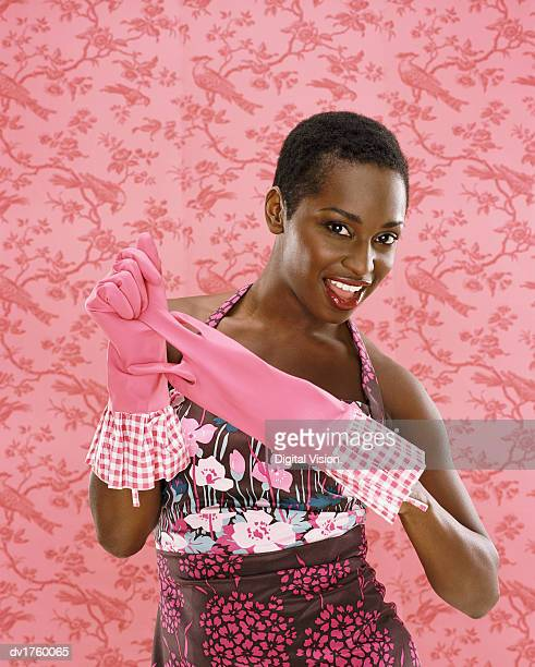 Portrait of a Woman Removing Rubber Gloves