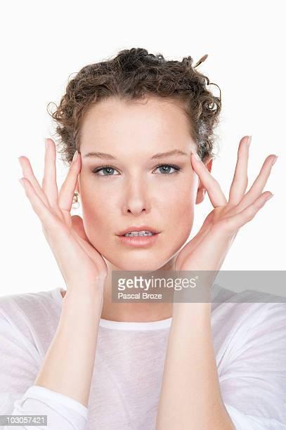 Portrait of a woman rubbing temples