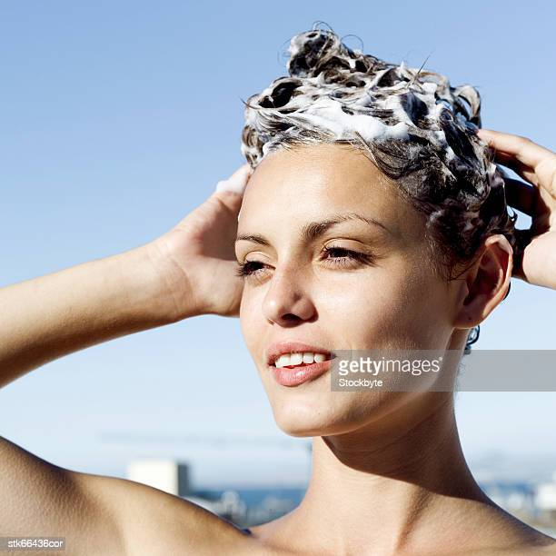 portrait of a woman shampooing her hair - washing hair stock pictures, royalty-free photos & images