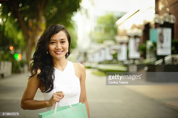 Portrait of a woman shopping on Orchard Road