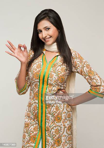 portrait of a woman showing ok sign and smiling - salwar kameez stock pictures, royalty-free photos & images