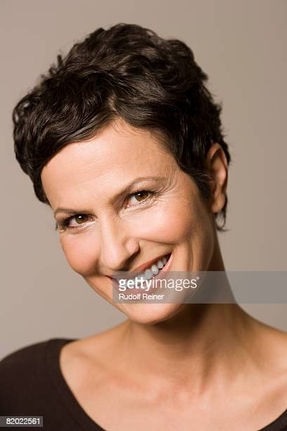 Mature woman smiling, portrait, close-up