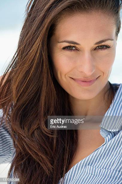 Portrait of a woman smiling on the beach