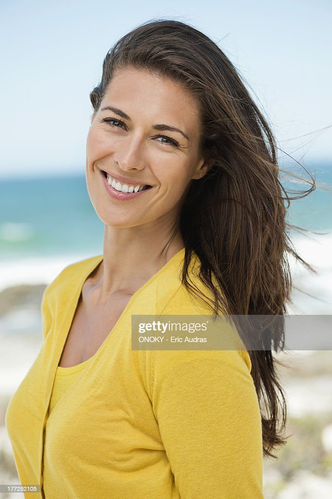 Portrait of a woman smiling on the beach : Stock Photo