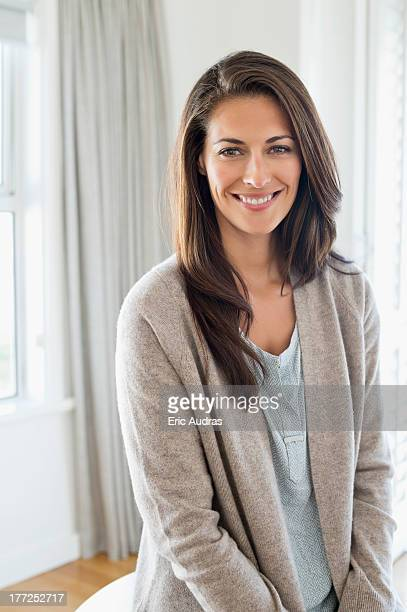 portrait of a woman smiling - mid adult woman sweater stock pictures, royalty-free photos & images