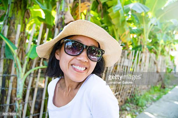 portrait of a woman smiling to the camera - camera point of view stock photos and pictures