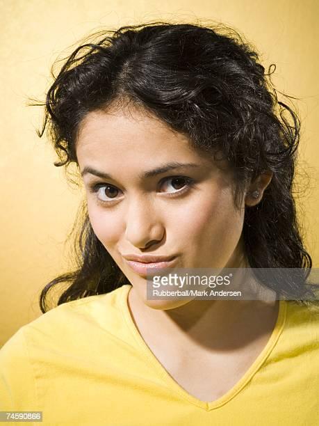 Portrait of a woman smirking