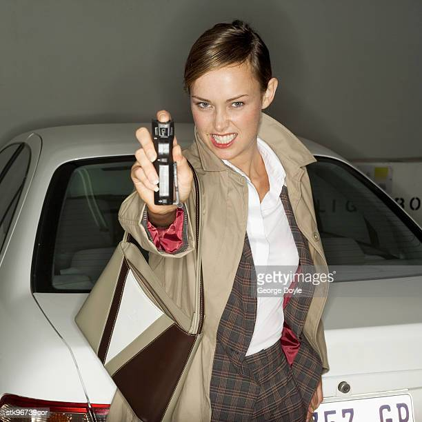 portrait of a woman spraying pepper spray - pepper spray stock pictures, royalty-free photos & images