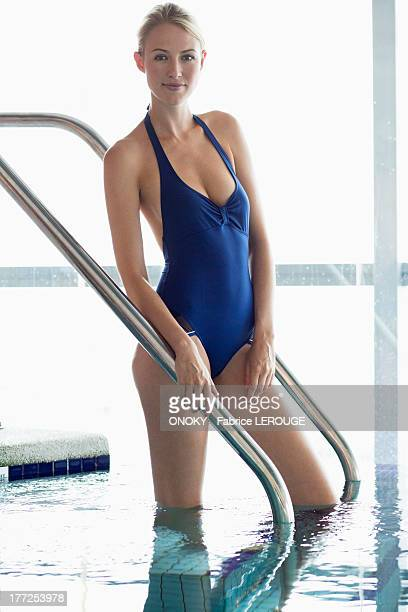 portrait of a woman standing in a swimming pool - onoky stock-fotos und bilder