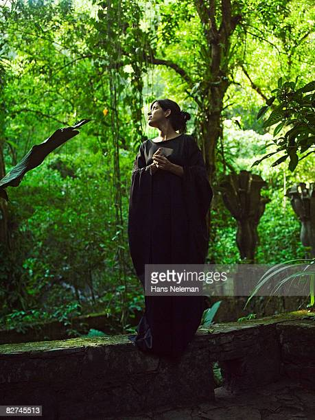 portrait of a woman standing in the forest - las posas stock pictures, royalty-free photos & images