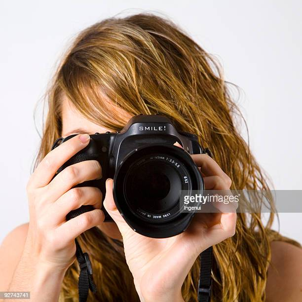 Portrait of a woman taking a picture