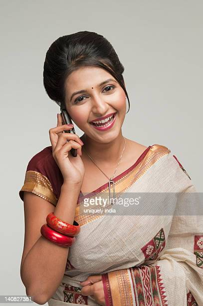 portrait of a woman talking on a mobile phone - sari stock pictures, royalty-free photos & images