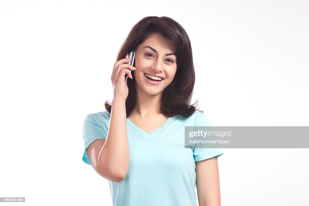 Portrait of a woman talking on a mobile phone : Stock Photo