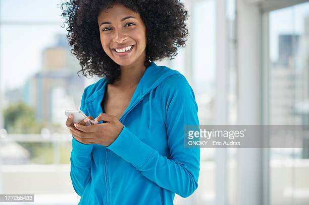 Portrait of a woman text messaging on a mobile phone