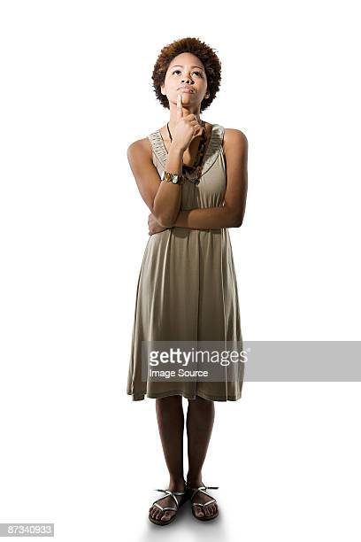 portrait of a woman thinking - chin stock pictures, royalty-free photos & images