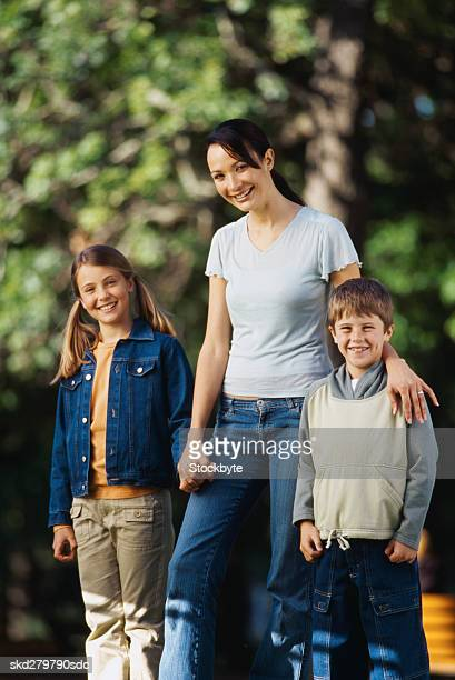 Portrait of a woman walking outdoors with her children (6-10)