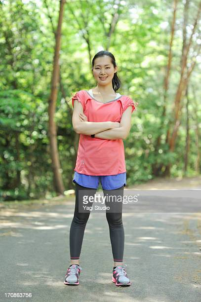 portrait of a woman wearing a jogging wear - スポーツウェア ストックフォトと画像