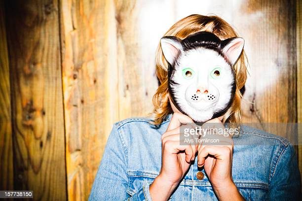 portrait of a woman wearing a mask - mask disguise stock pictures, royalty-free photos & images