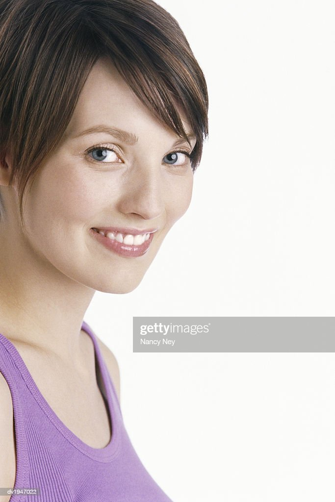 Portrait of a Woman Wearing a Purple Vest : Stock Photo