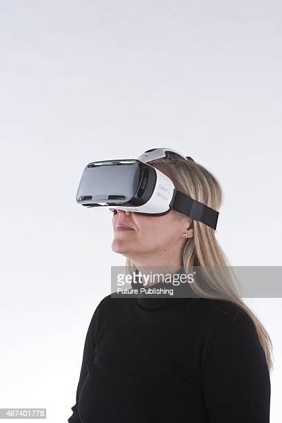 Portrait of a woman wearing a Samsung Gear VR headset taken on March 11 2015