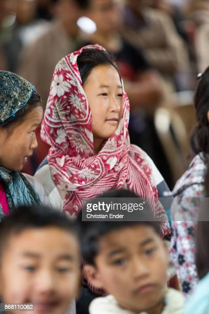 Portrait of a woman wearing a sari at ceremony inside a church in Kalimpong
