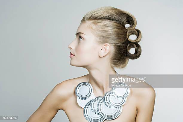 Portrait of a woman wearing a tin can necklace