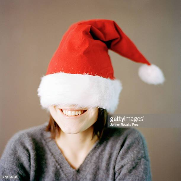 Portrait of a woman wearing a too big Father Christmas cap Sweden.