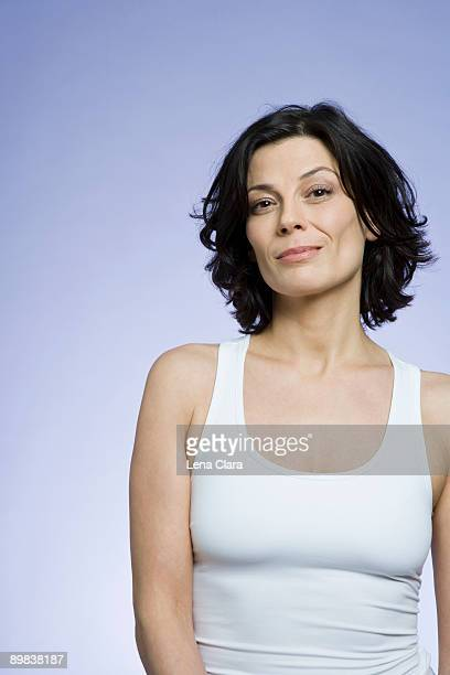 portrait of a woman wearing a white top - waist up stock pictures, royalty-free photos & images