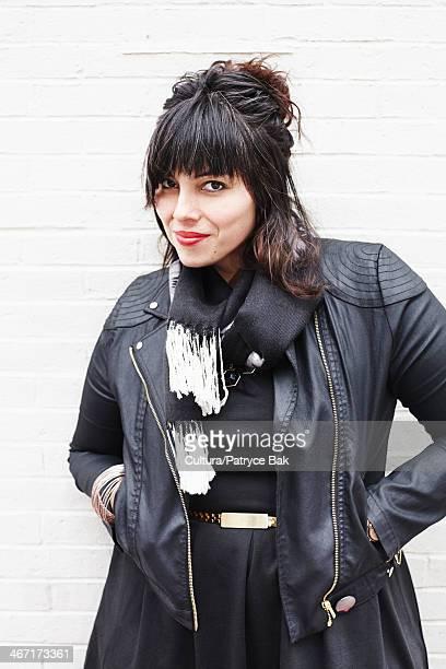 Portrait of a woman wearing leather jacket