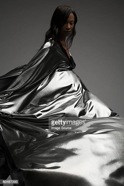 portrait of a woman wearing silver dress - grey dress stock pictures, royalty-free photos & images