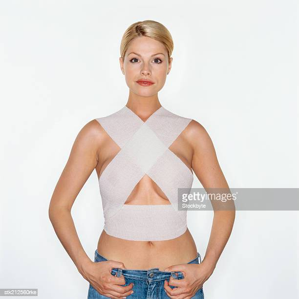 portrait of a woman wearing support bandages after breast surgery
