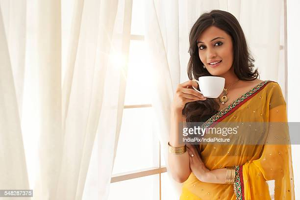 Portrait of a woman with a cup of coffee
