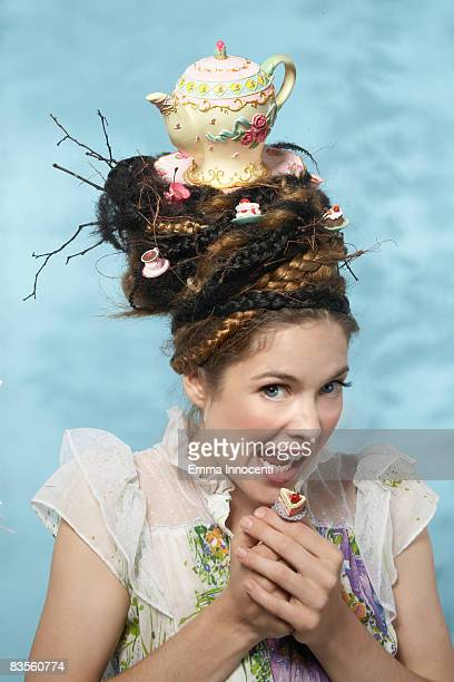 Portrait of a woman with a teapot on her head