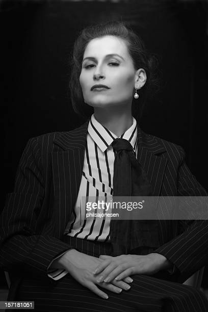 Portrait of a woman with a vintage style on black background
