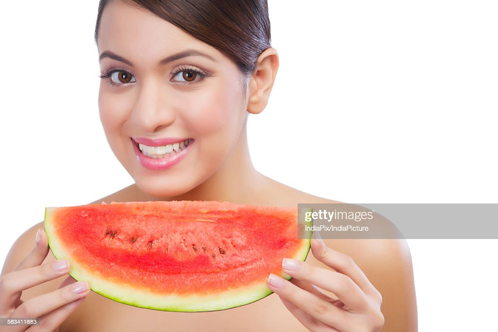 Portrait of a woman with a watermelon : Stock Photo